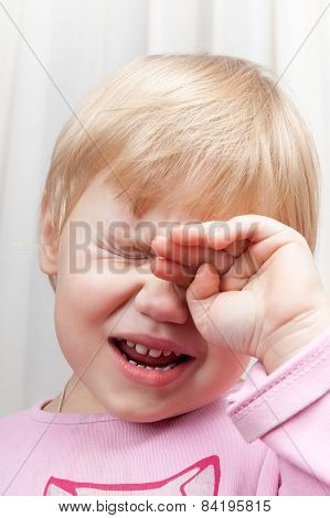 Portrait Of Blonde Crying Caucasian Baby Girl