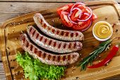 pic of grilled sausage  - grilled sausages on the grill on the board - JPG