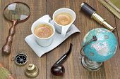 pic of spyglass  - Earth Globe Vintage Spyglass Magnifying Glass Compass Two Notebooks Smoking Pipe and Two Espresso Coffee Cups On The Grunge Wooden Table - JPG