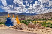 stock photo of jammu kashmir  - Three colourful buddhist religious stupas at Leh Ladakh Jammu and Kashmir India - JPG