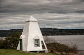 foto of wooden shack  - White wooden shingle building by the coast of maine - JPG