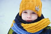 pic of little boys only  - little boy on a walk in the winter yellow cap