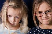 pic of mischief  - Two girls with suspicious gaze - JPG