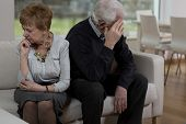stock photo of sofa  - Offended elder couple sitting on the sofa - JPG