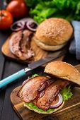 foto of burger  - Home made burger with bacon on wooden board - JPG