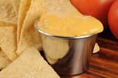 pic of nachos  - Corn chips and nacho cheese sauce closeup shallow depth of field - JPG