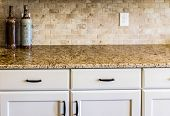 stock photo of granite  - A Modern empty kitchen with granite countertops - JPG