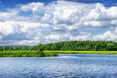 picture of cloudy  - Beautiful summer river landscape in cloudy day - JPG