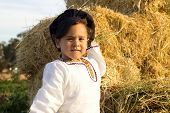 picture of haystack  - Country boy in national costume plays in a haystack - JPG