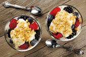 picture of yogurt  - Healthy mixed berry granola and yogurt parfaits downward view on wood - JPG