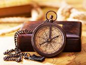 stock photo of longitude  - old retro compass on a vintage map