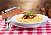 stock photo of spaghetti  - plate of spaghetti bolognese with green basil  - JPG