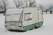image of camper  - camper covered by  snow in winter on a cloudy day - JPG