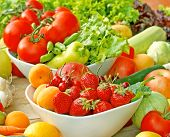 stock photo of fruit bowl  - Fresh organic fruits and vegetables in bowls on table - JPG