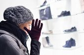 pic of boutique  - Casualy winter dressed lady window shopping in front of sinfully expensive boutique store dispaly window - JPG