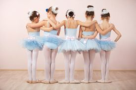 stock photo of ballerina  - Group of five little ballerinas posing together with back to camera - JPG