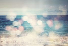 picture of sunny season  - background of blurred beach and sea waves with bokeh lights sandy beach with turquoise water bright white sun lights bokeh travel and summer holidays concept vintage effect - JPG