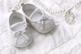 picture of newborn baby girl  - Baby girl shoes on white background - JPG