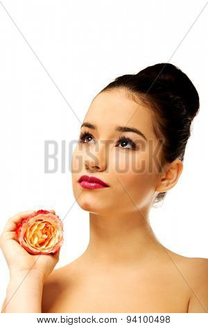 Sensual spa woman with pink rose.