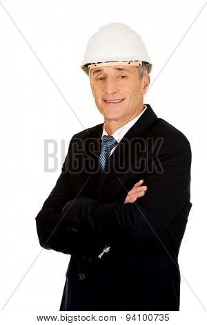 Smiling mature engineer with hard hat.