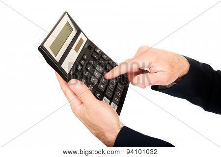 Financier's finger pushing the button on calculator.