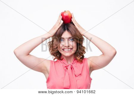Happy woman holding apples on head isolated on a white background