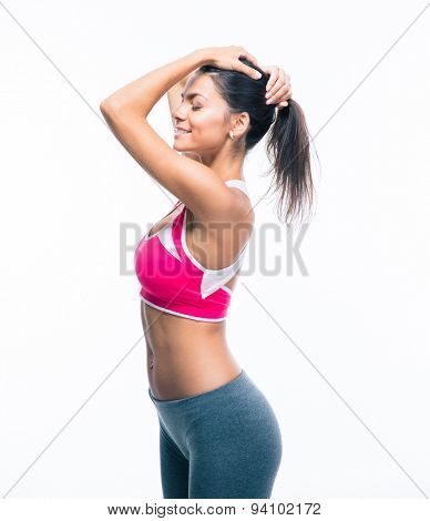 Woman holding her hair in ponytail isolated on a white background