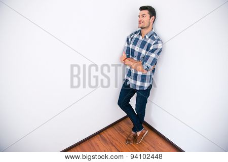 Businessman in casual cloth standing corner of the room in office