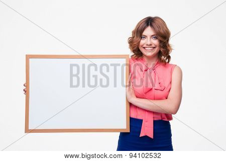 Smiling woman holding whiteboard isolated on a white background. Looking at camera