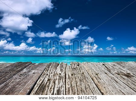 Beautiful beach and old wooden pier at Seychelles, La Digue