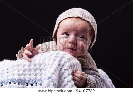 Newborn baby boy on black background