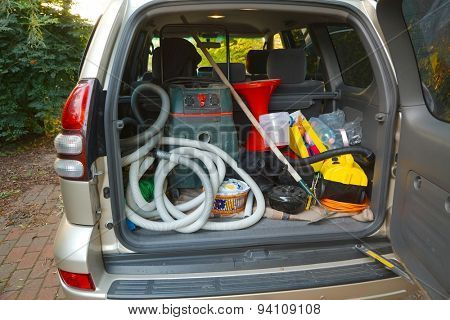 Trunk of a car loaded with equipment