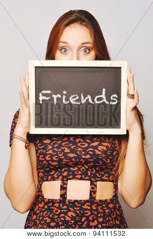 Young Woman Holding A Chalkboard Saying Friends