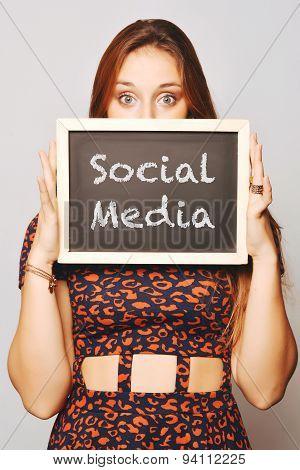 Young Woman Holding A Chalkboard Saying Social Media