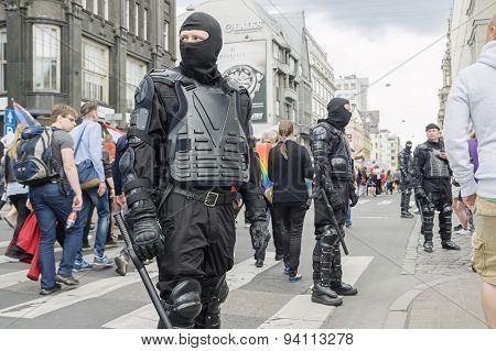 RIGA, LATVIA - JUNE 20: EuroPride 2015 parade in Riga on JUNE 20, 2015.  Police cordon