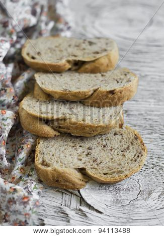 Whole Grain Bread With Pecans On A Light Wooden Background