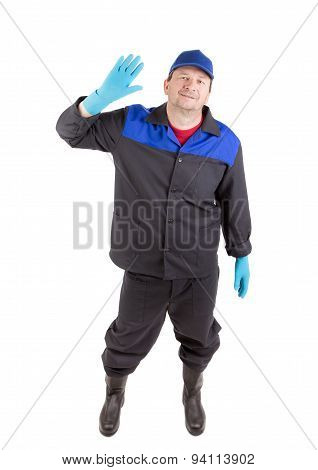 Worker in blue coat and hat.
