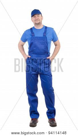 Worker in blue overalls