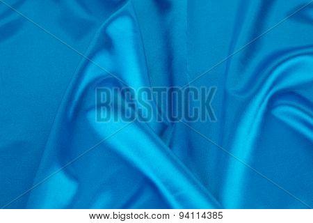 Blue silk drapery.