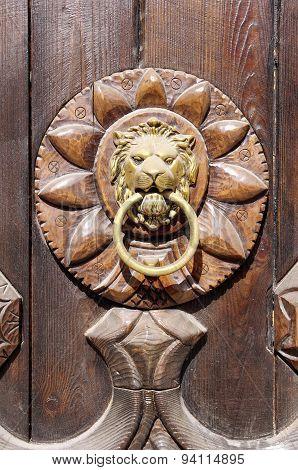 Lion Head, Door Knocker On Wooden Door