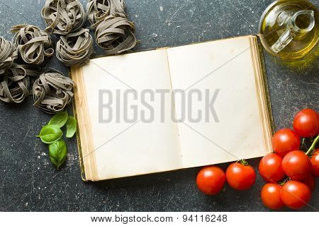 top view of blank cookbook and ingredients