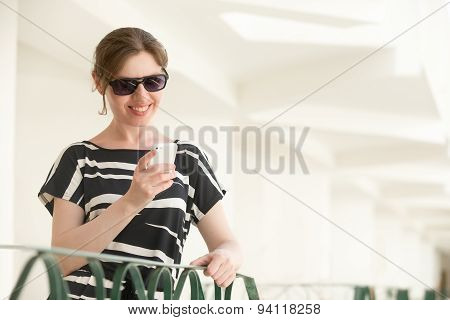Young Happy Woman Using App Mobile On Phone