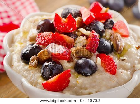 Oatmeal With Fresh Berries And Nuts  For A Healthy Breakfast.