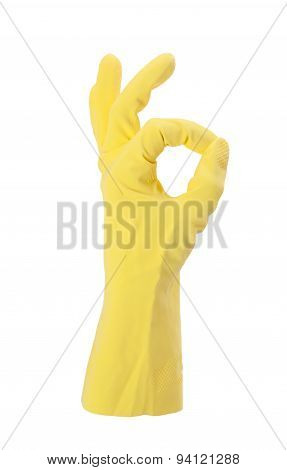 Hand Gesturing With Yellow Cleaning Product Glove
