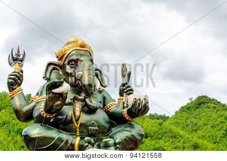 Green Ganesha Hindu God Statue Close Up On Natural Background