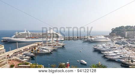 MONTE CARLO, MONACO -  SEPTEMBER 20, 2008: View on Port Hercules with luxurious yachts and a cruise