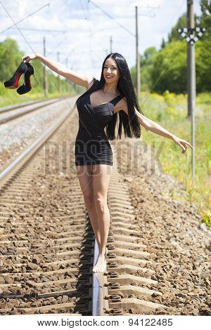Beautiful Young Woman Walking On Railway Tracks