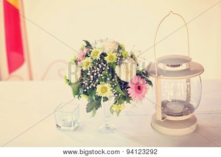 Flowers And Lamp On Table