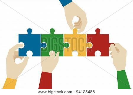 Hands assembling jigsaw puzzle pieces