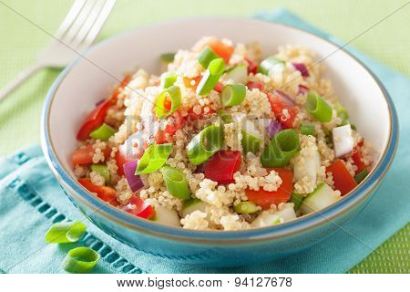 healthy quinoa salad with tomato cucumber onion chives